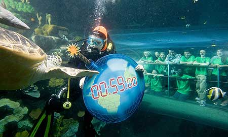 Pictured with naturalist and broadcaster Nick Baker as a diver carries a symbolic �time-bomb� earth through the ocean tank at the National Sea Life Centre, are from left to right: Standing - Tierney Carter, Rebecca Johnson, Amber Rowland (Nick Baker), Ricky Froud, Matthew Newsome and Abigale Rudland. Kneeling - Molly Clayton, Hannah Layton and Kwabe Tenkorang.