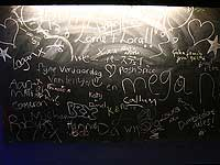 Visitors leave messages on the blackboard for Lora and Lorne