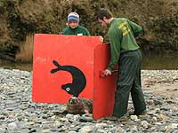 Claire and Dan helping a seal pup towards the sea - Photo was taken by Simon Bone